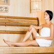Half-naked girl relaxing in sauna — Stock Photo #26134717