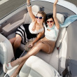 Top view of women in the car with their hands up — Stock Photo #26135199