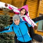Cute couple having fun during winter holidays — Stock Photo