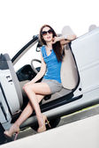 Pretty woman sits in the cabriolet with side door opened — Stock Photo