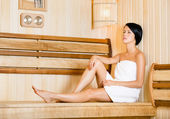 Half-naked girl relaxing in sauna — Stock Photo