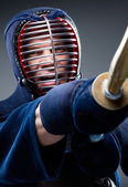 Close up of kendo fighter training with shinai — Stock Photo