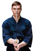 Kendoka in hakama training with sword — Stock Photo
