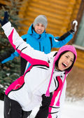 Happy couple playing at snowballs and having fun — Stock Photo