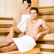 Half-naked man and woman relaxing in sauna — Stock Photo