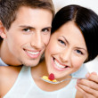Close up of man feeding his girlfriend — Stock Photo