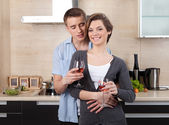 Couple with goblets hugs one another — Stock Photo