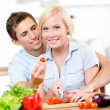Young couple cooking breakfast together — Stock Photo