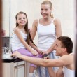 Stock Photo: Family of three people brush their dents