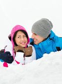 Man and woman lying in snow — Stock Photo