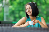 Girl drinks tea at the bar — Stock Photo
