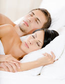 Couple sleeping in bedroom — Stock Photo