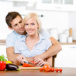 Young couple preparing breakfast together — Stock Photo #30935243