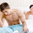 Young young married couple argues in bed — Stock Photo