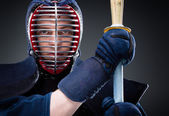 Close up of kendo fighter with shinai — Stock Photo