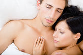 Close up of couple sleeping in bedroom — Stock Photo