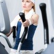 Athlete woman training on simulators in gym — Stok fotoğraf