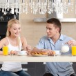 Couple has a snack in the kitchen — Stock Photo