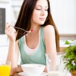 Girl eating dieting muesli and orange juice — Stock Photo