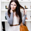 Stock Photo: Half-length portrait of female in shopping center