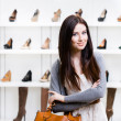 Half-length portrait of lady in shopping center — Stockfoto