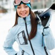 Half-length portrait of girl handing skis — Stock Photo