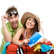 Couple packs up suitcase with clothing for trip — Stock Photo #31277865