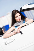 Pretty female driver showing the car key — Stock Photo