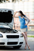 Woman repairing the broken car on the highway — Stock Photo