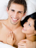 Close up view of couple lying in bedroom — Stock Photo