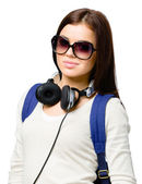 Teenager with rucksack and earphones — Stock Photo