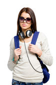 Teenager with knapsack and headphones — Stock Photo