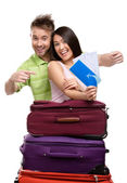 Couple with trunks and tickets — Stock Photo