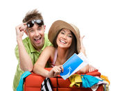 Couple packs up suitcase with clothing for trip — Stock Photo