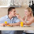 Married couple has breakfast in the kitchen — Stock Photo