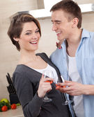 Smiley couple with goblets embraces one another — Stock Photo