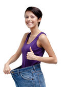 Slim woman wearing big jeans — Stock Photo