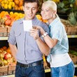 Couple with shopping list — Stock Photo #32070287