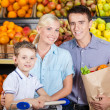 Family goes shopping — Stock Photo