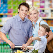 Family in the shop — Stock Photo