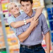 Girl embraces man in the market — Stock Photo