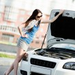 Woman repairing the broken car on the road — Stock Photo