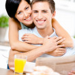 Woman hugs eating boyfriend — Stock Photo