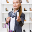 Young woman showing credit card — Stock Photo