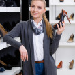Woman chooses high heeled shoes — Foto de Stock