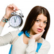 Amazed woman with alarm clock — Stock Photo