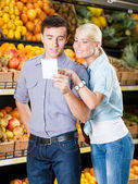 Couple with shopping list — Stock Photo