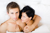 Close up view of couple lying in bed — Stock Photo