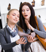 Salesperson shows footwear — Stock Photo