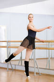 Athlete dancing near barre in dancing hall — Stock Photo